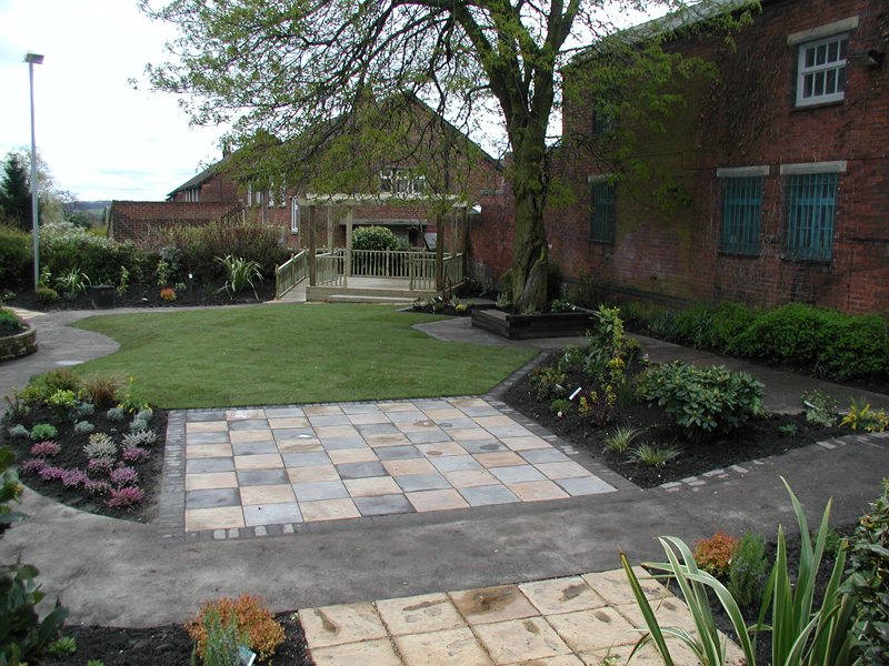 Soft landscaping chess board paving feature pergola for Soft landscaping ideas